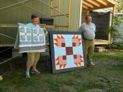 Marsha and Bill McElroy with Bear Paw Block and original   quilt